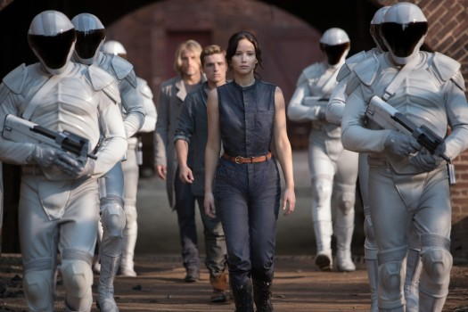 "This image released by Lionsgate shows Jennifer Lawrence as Katniss Everdeen, from foreground to background, Josh Hutcherson as Peeta Mellark and Woody Harrelson as Haymitch Abernathy in a scene from ""The Hunger Games: Catching Fire."" (AP Photo/Lionsgate, Murray Close) ORG XMIT: NYET536"